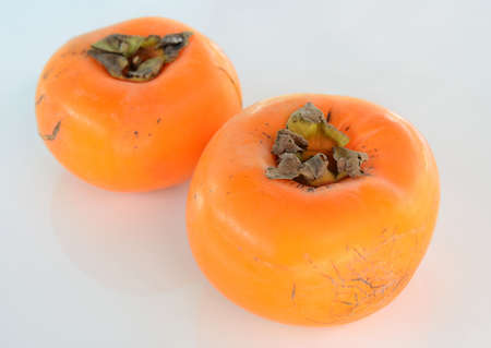 persimmons on the white background