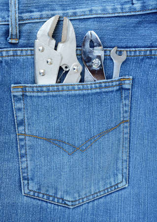 hand tool on jean background photo