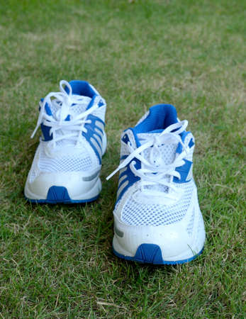 running shoe on grass