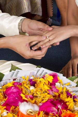 wedding ring, Thai wedding ceremony showing wearing ring.
