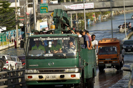 BANGKOK, THAILAND - NOV 12: Commuter transporting on the big truck after the city was flooded on November 12, 2011 in Bangkok, Thailand.
