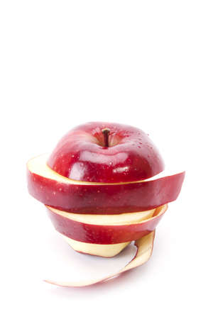 peal: peal apple, red apple pealed and sliced put back to round shape. Stock Photo