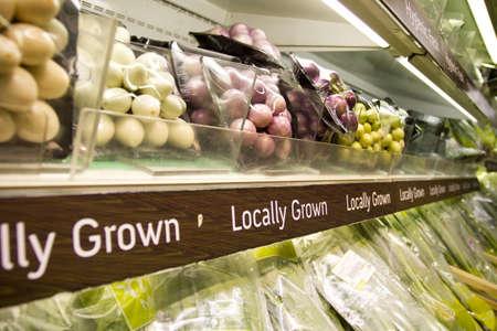 vegetables supermarket: grocery store, full shelf of Thai peel clean herb in supermarket.