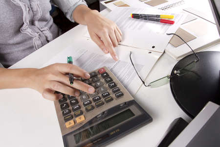 busy work, business woman calculating job on working day. Stock Photo