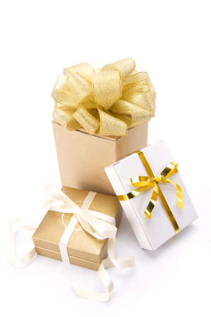 group of gold gift, three gold gift boxes with gold classic ribbon.