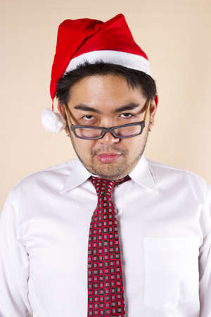 to sulk: sulk Santa, Businessman wear santa hat acting sulk.