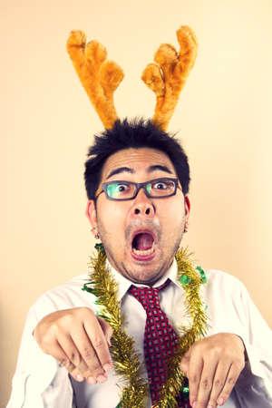 Man deer, Businessman wear reindeer horn act funny reindeer.