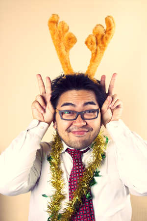 Cute Reindeer, Businessman with Rudolf horn acting cute.  photo