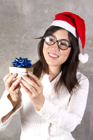 Santa present, female Santa holding present box with blue ribbon smiling. photo