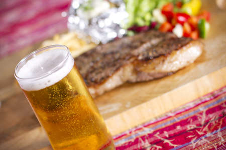 steak and meal, set of beef steak and beer on the table