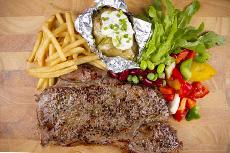 steak, set of steak with salad, fries and baked potato. photo