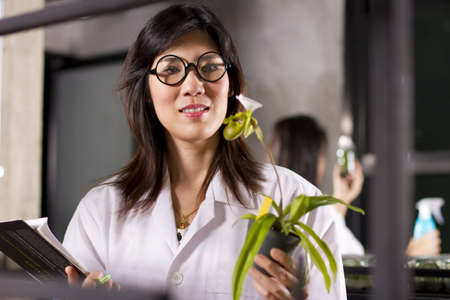 orchid growth, two scientists working in lab about growing plant. Stock Photo - 11747140