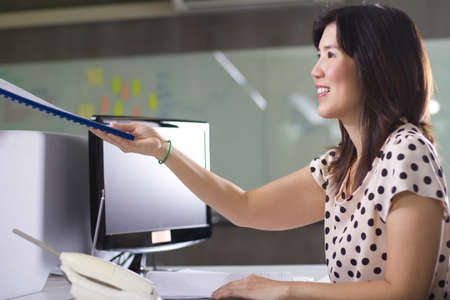 Transfer file, Asian girl receive file from colleague at office. Stock Photo - 11747109