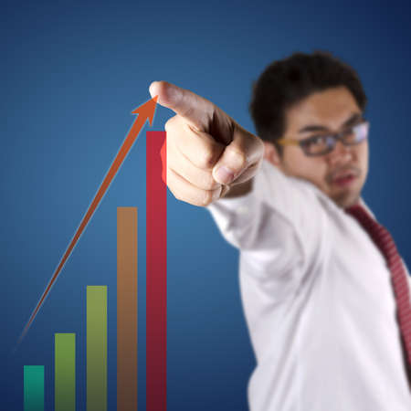number one, businessman pointing to the highest chart. photo