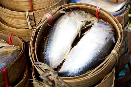 sardine basket, two sardines in bamboo basket. Stock Photo - 11917893