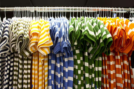shirt row, colorful shirt arrange in a row in mall. photo
