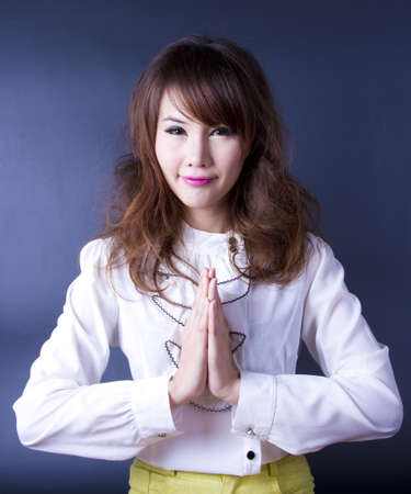 Sawasdee, Female model join own palms to make praying gesture. photo