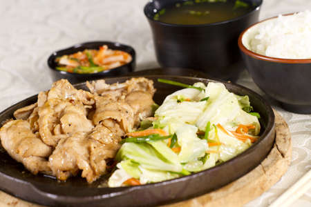soysauce: pork yakiniku, hot pan fried pork yakiniku with rice and soup. Stock Photo