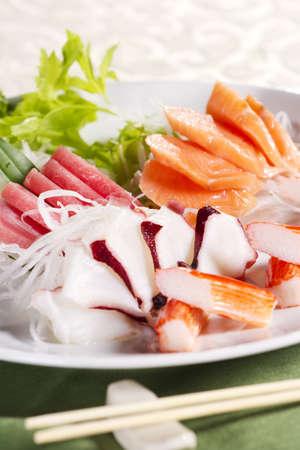 mix sashimi, mix raw fresh fish with vegetable Japanese food. photo