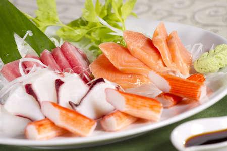 mix sashimi, mix raw fresh fish with soy sauce Japanese food. photo