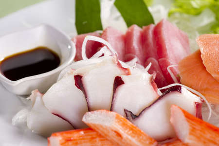 mix sashimi, dish of mix sashimi with soy sauce aside. photo