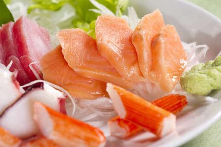 mix Japanese, fresh raw salmon,crab stick, octopus, tuna  together. photo