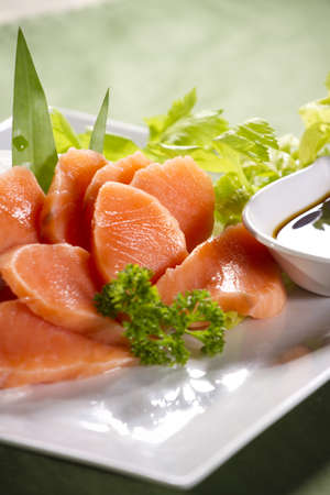orange salmon, fresh salmon japanese food decorated sashimi with wasabi and soy sauce. Stock Photo