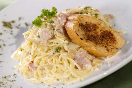 pasta white sauce, white sauce pasta carbonara with bread photo