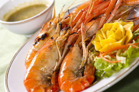 grilled prawns, orange grilled prawn with sour sauce in a dish