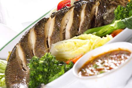 snake fish dinner, dish of whole snake fish steamed with vegetable Stock Photo - 12947034
