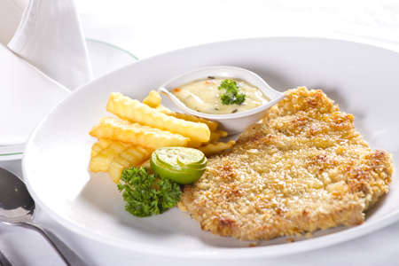 pork chop dish, white dish with pork chop steak a la carte Stock Photo