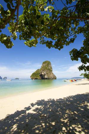 Thailand coast, white sand beach under tree shadow and island of Krabi, Thailand Stock Photo - 13192040