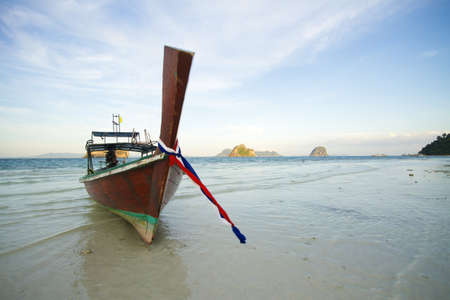 longtail: long tail boat, one long tail boat parking on the beach