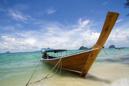 long tailed boat: long tail boat, one long tailed boat park on the white beach