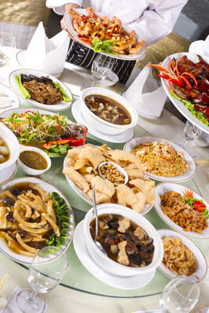 mixed chinese food, mixed Chinese food with chef holding some dishes