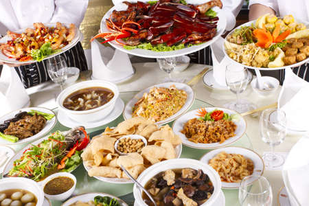 china cuisine: various chinese food, mixed Chinese food with chef holding some dishes Stock Photo
