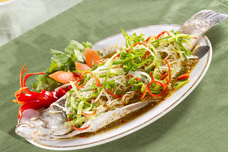 steamed snapper, soy sauce seasoning whole steamed snapper  photo
