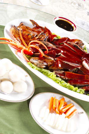 Beijing duck set, Brown Shiny Beijing duck with flour and side dishes photo