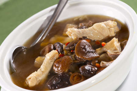 Chinese soup, Chinese style soup with mushroom and chicken Stock Photo