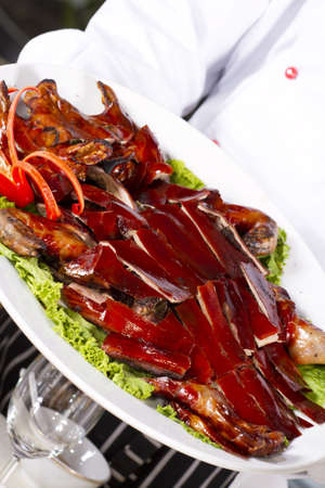 grilled young pig, grilled brown young pig on dish a Chinese style food photo