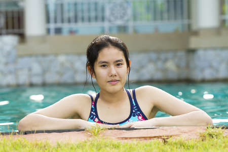 sport girl, Asian girl ready to swim in the pool photo