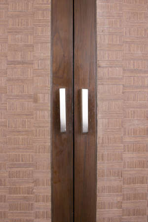 closet door, brown wood closet doors with handles photo