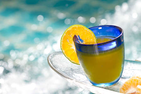 pool bars: orange cocktail, orange cocktail in blue glass by Jacuzzi pool
