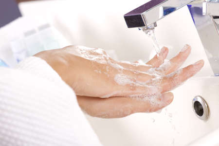 Hand wash,  female hand washing soap in tap water Stock Photo