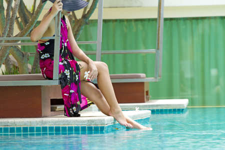 Beauty by the pool, woman in Pink flower painted sarong by the pool photo
