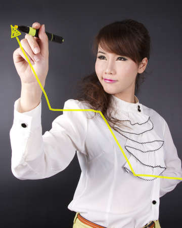 success, female model writing high up graph meaning success Stock Photo - 15008085