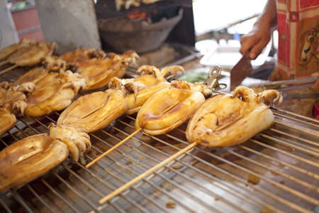 grilled squid, grilled squid in stick street food in Thailand photo