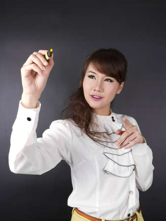 writing, Asian cute female writing on wall with pen Stock Photo - 15261785