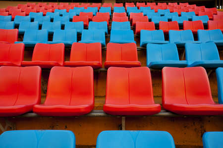 stadium seats, red and blue seat on stadium steps bleacher photo