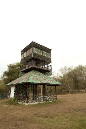 sentry: animal observation tower, camouflage printed animal observation tower in the wood Editorial
